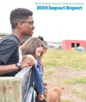 Image of the cover of the MUSC Boeing Center for Children's Wellness 2019 Impact Report showing children on a farm