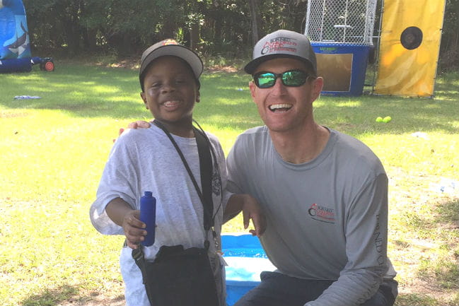Firefighter Ross Vezin with camp participant Joshua Calhoun