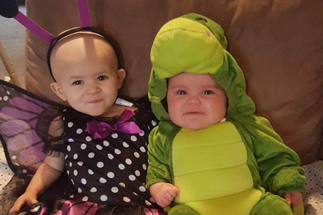 Victoria and Reesie in their Halloween costumes.