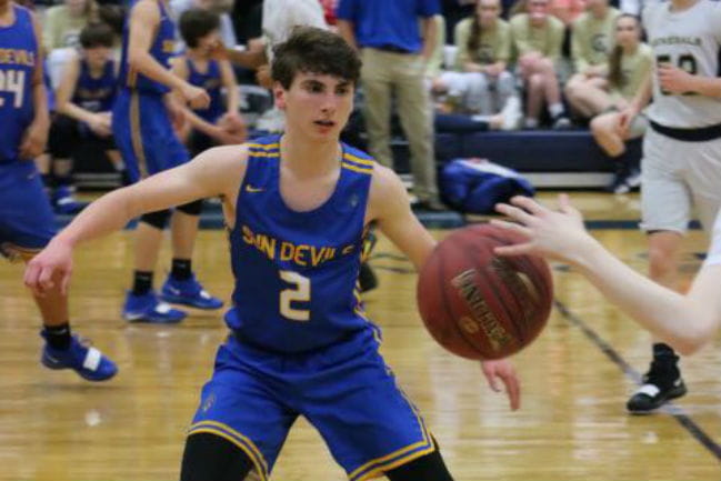 Avery VanderWeele playing basketball