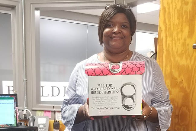 Chandra Jones with pop tab donation box