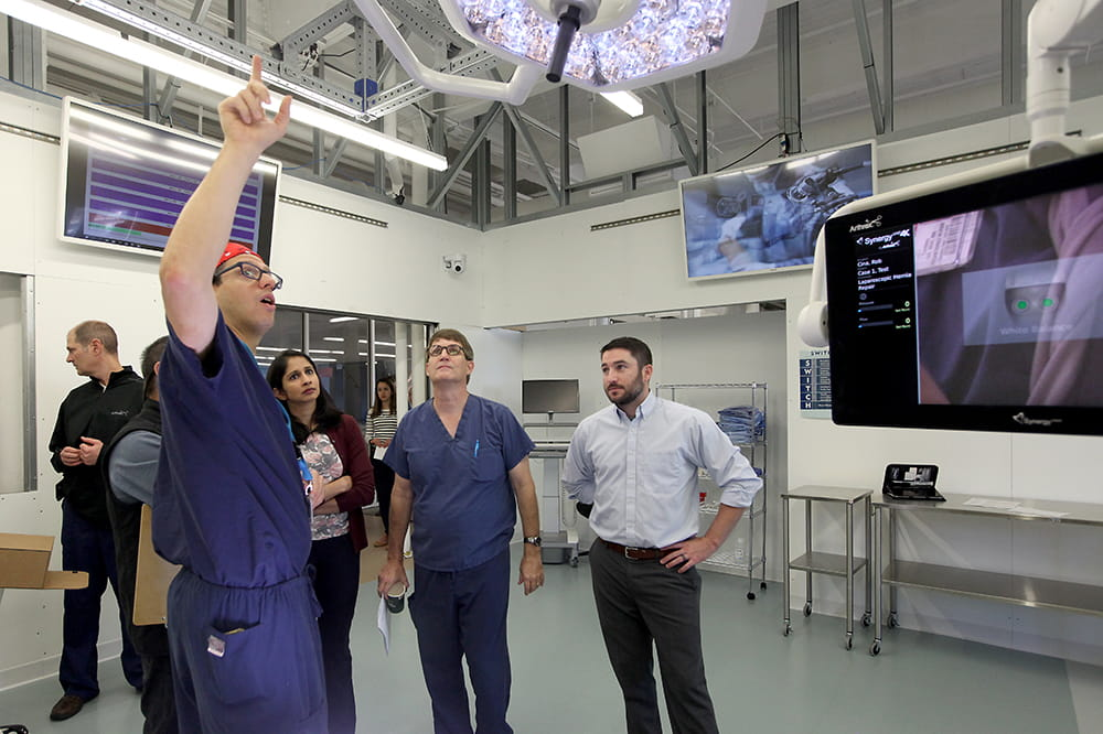 people talk in a simulated operating room
