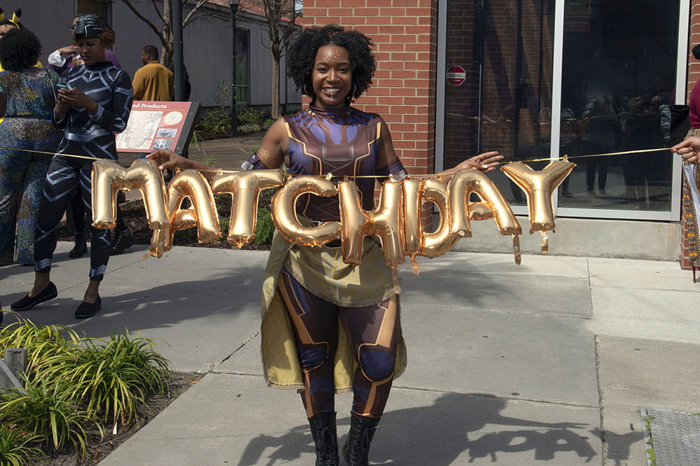 Medical student with Match Day balloons