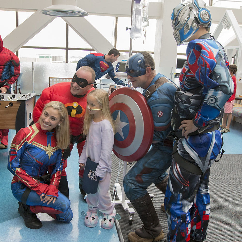 Group of superheroes with girl