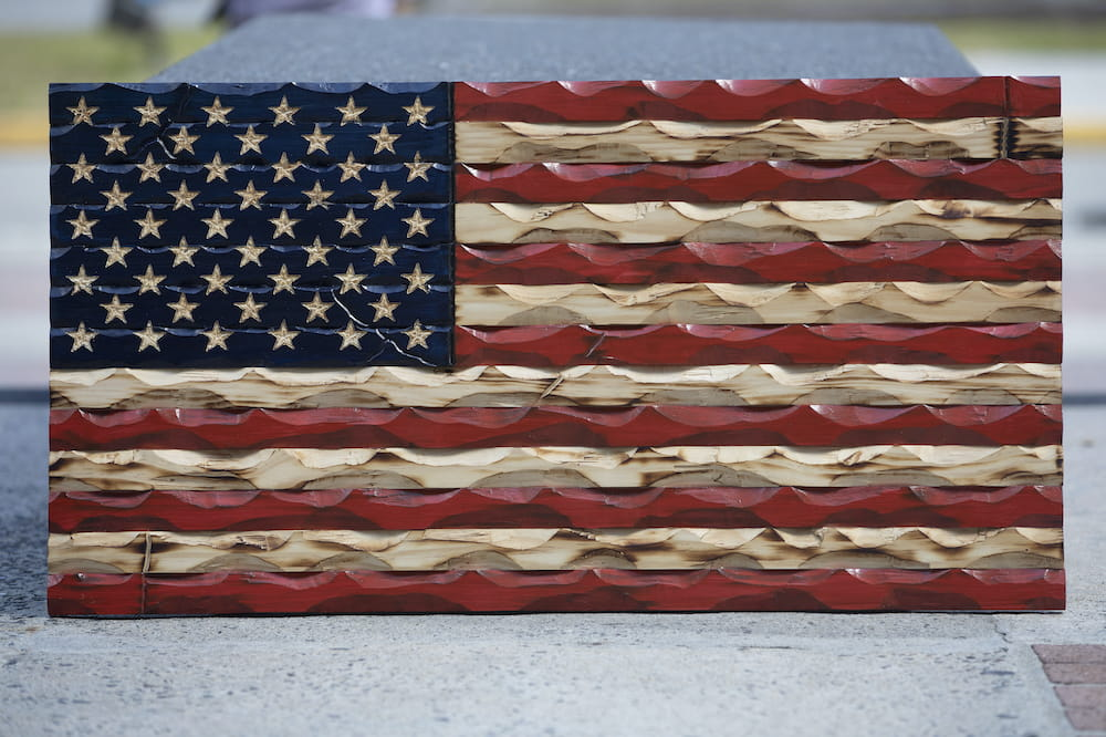 Close up of hand carved American flag in red, white and blue